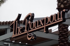 The Rouxpour overhang sign closeup view
