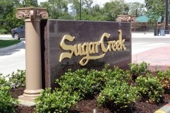 Sugar Creek entrance monument sign side view