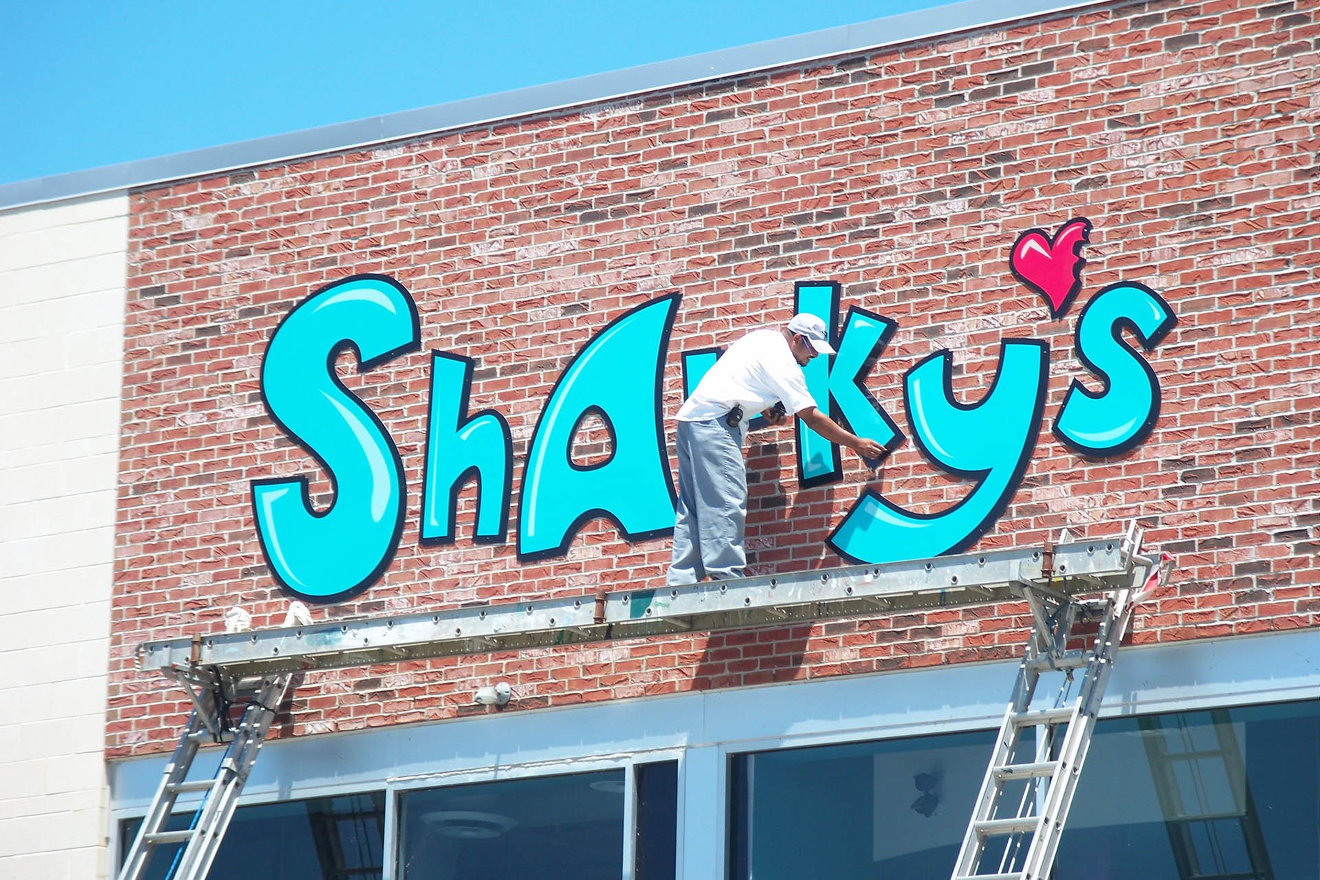 working on exterior sign